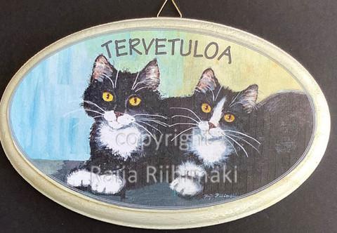 Tervetuloa kyltti, kaksi mustaa kissaa