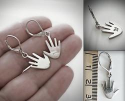 Hopeakorvakorut Kädet