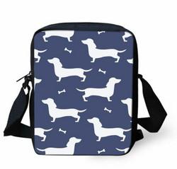 Laukku, valkoiset mäyräkoirat sinisellä pohjalla