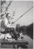 Man and cat fishing