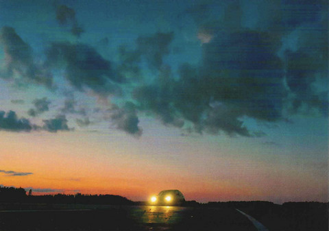 Car on a night road
