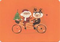 Christmas couple on a tamdem