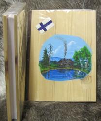 Vieraskirja: Puukannessa maisemamaalaus