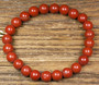 Rannekoru punainen jaspis 8mm, joustavassa  silikoninauhassa