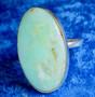 Sormus: kryso-opaali 21mm säädettävä, ovaali kivi 20x35mm. Unikki!