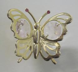 Magneetti: Perhonen, kultakristalli, vaaleanpunaiset kristallit ja 24 karaatin kultaus.
