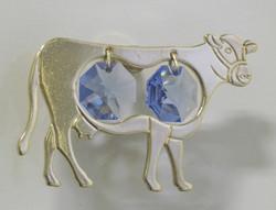 Magneetti: Lehmä, kultakristalli, siniset kristallit ja 24 karaatin kultaus.