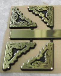 Kellotarvikkeet kulmakoristeet kullan väriset 25mm muovia
