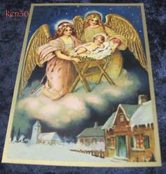 Joulukortti 2 enkeliä Jeesus-lapsen seimellä, kirkko taustalla. ken30