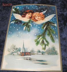 Joulukortti 2 enkeliä kirkon yllä. ken05