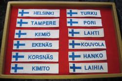 Hihamerkki KOUVOLA Suomen lippu 23x98mm patch