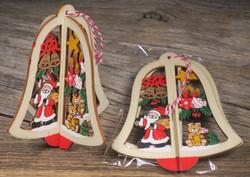 Joulukoriste: joulukellossa joulupukki, nalle, joulukellot, kuusenkynttilät, tähti