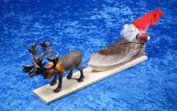 Joulukoriste: Poro vetää joulupukkia ja rekeä, Rekipeittona aitoa poronkarvaa
