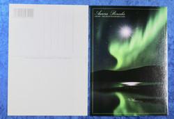 Postikortti Revontulimaisema, kuutamolla. Aurora Borealis in Lapland.