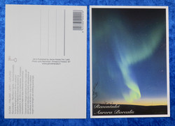 Postikortti revontulet ja tähtitaivas