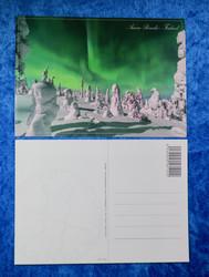 Postikortti vihreät revontulet ja lumiset tykkylumi puut