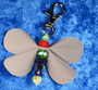 Heijastinperhonen, erivärisiä lasihelmiä, karbiinilukko