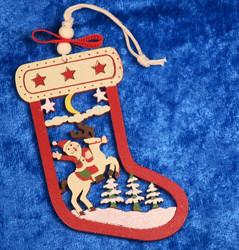 Joulukoriste: joulupukki ja poro sukassa, puuta