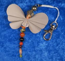 Heijastin LEIJONA onnenkivet  perhonen, karbiinihaka