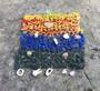 Seinäkoriste lapin kiviä, poron hammas, poronluita, puuta. Nro RM