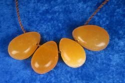 Riipus kalsiitti, keltainen porattu Orangecalcite