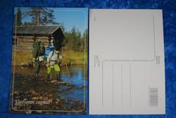 Postikortti Lappi kesällä - vaeltajat joella rinkat selässä