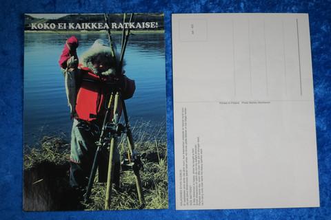 Postikortti lapsi ja kala rannalla