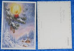 Joulukortti kynttilä kuusen oksalla, kirkko taustalla. Joulurauhaa