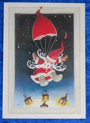 Joulukortti joulupukki laskeutuu laskuvarjolla lumeen
