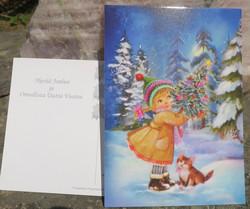 Joulukortti joulukuusi, tyttö ja kissa metsässä
