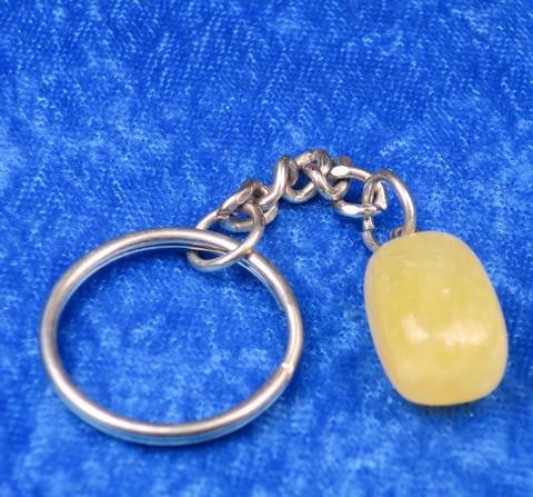 Avaimenperä keltainen kalsiitti rumpuhiottu