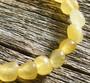 Kalsiitti keltainen rumpuhiottu 7x9 mm irtohelmi