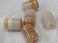 Akaatti valkoinen ja oranssi kirjava putki 8x12mm irtohelmi