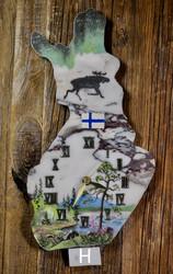 Seinäkello: Suomikellon maisemat on tehty kivimurska-tekniikalla (H)