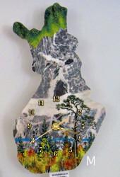 Seinäkello: Suomikellon maisemat on tehty kivimurska-tekniikalla (M)
