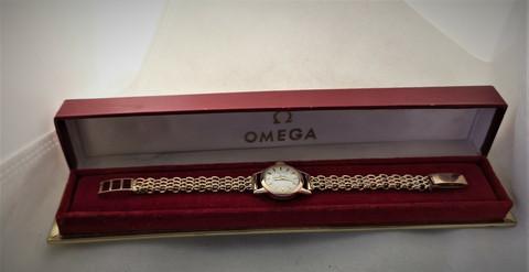 14ct kultainen vintage Omega huollettuna ja kultarannekkeella