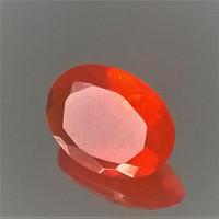 Erikoinen kirkas tulenoranssi opaali