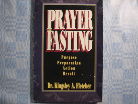 Praying and fasting, Dr. Kingsley A. Fletcher
