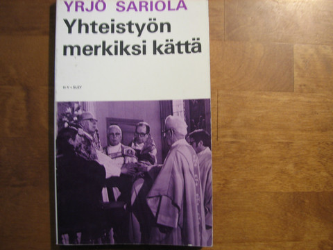 Yhteistyön merkiksi kättä, Yrjö Sariola