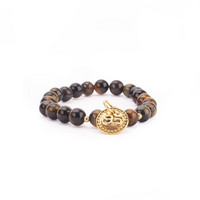 Mala-rannekoru - Tiikerinsilmähelmillä ja OM amuletilla, ruskea