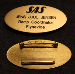 SAS, Scandinavian airlines, name tag. Blue text