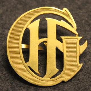 GHF, kirjaimet, käsinkaiverretut