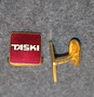 Taski, Cleaning equipment manufacturer. Cuff link