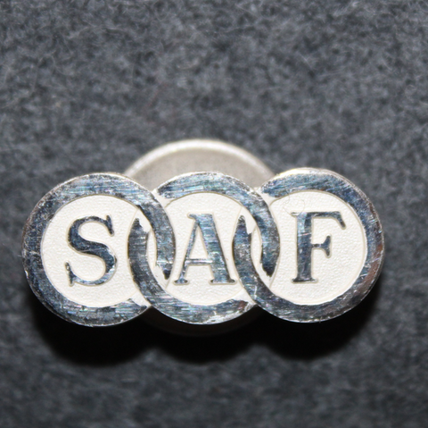 Svenska Arbetsgivareföreningen SAF, työnantajien ammattiliitto. Napiläpimerkki