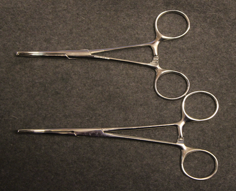 Locking surgical forceps, unissued.