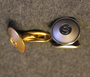 AB Sporrong. Button and medal manufacturer.. Cuff link