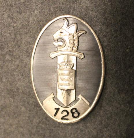 Suomen poliisin virkamerkki, Uusimaa no: 128