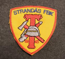 Strandäs FBK, Vapaapalokunnan kangasmerkki.