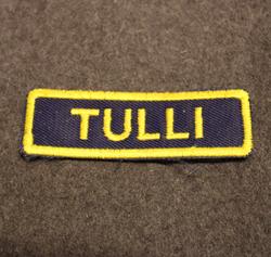 Suomen Tullin haalarimerkki.