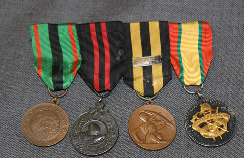 Medal bar of 4 medals for a civil defence man.